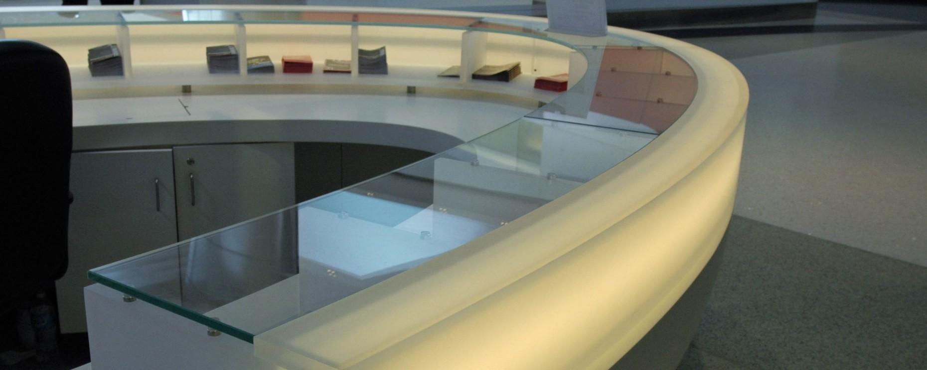 Terminal F Philadelphia International Airport. Thermoformed information desk  Materials: Corian, 3form, glass Architecture: Daroff Design General Contractor: Daniel J. Keating Construction