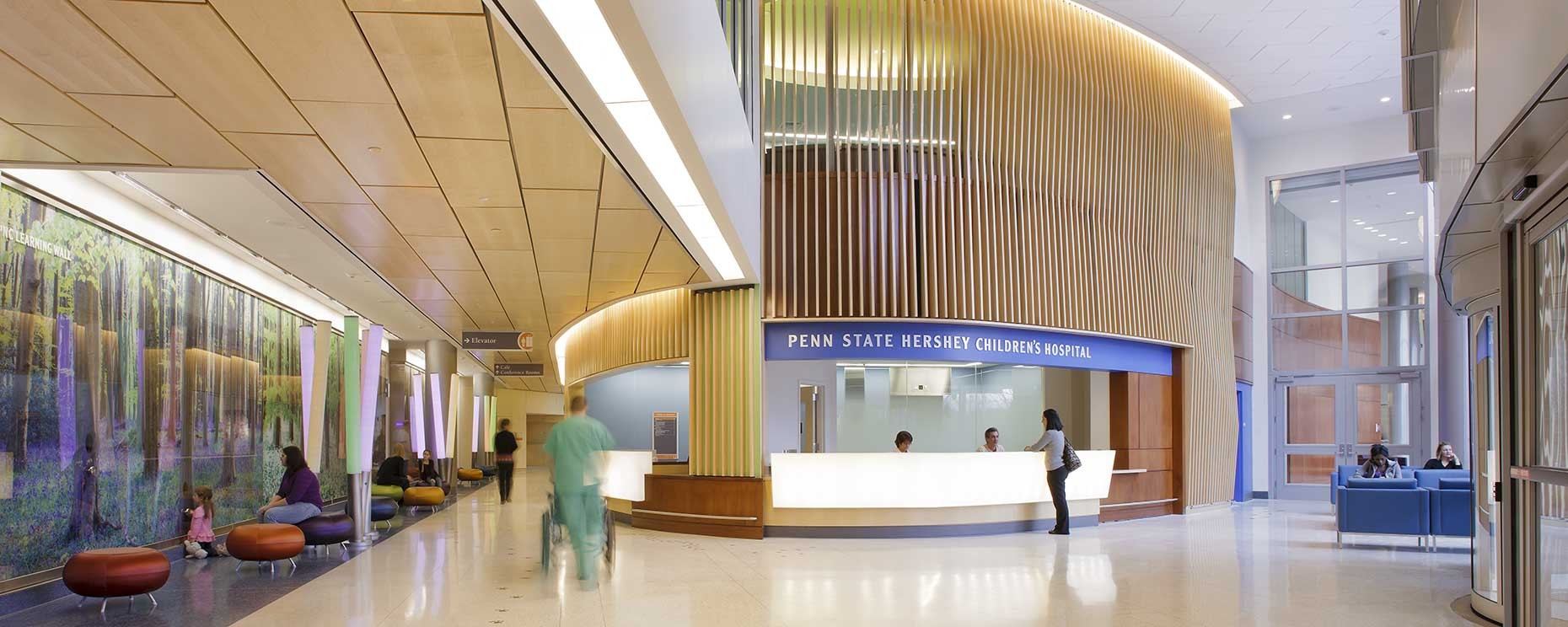 Penn State Milton Hershey Children's Hospital, Hershey, PA. Entrance Lobby  Materials: Corian, plastic laminate, wood, Trespa wall panels Architecture: Payette General Contractor: Quandel Group