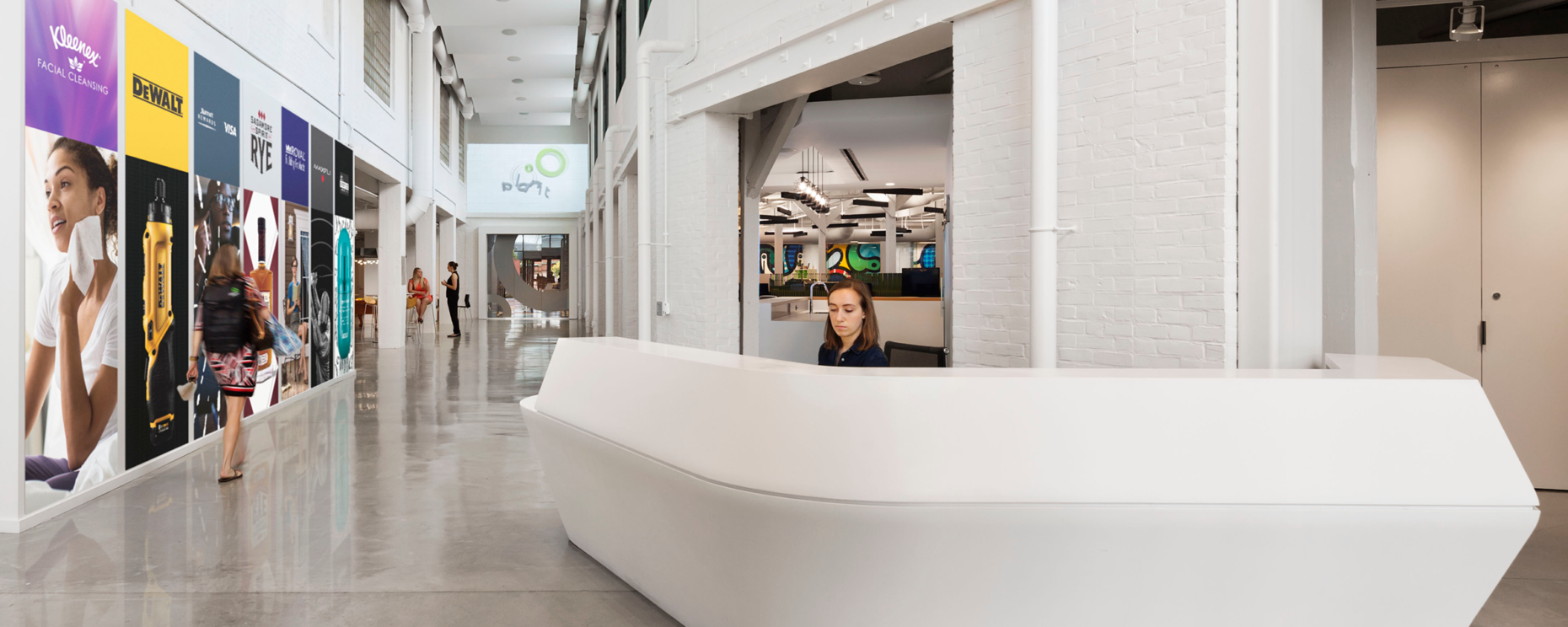 Planit Agency, Baltimore, MD. Durasein Arctic White Custom Thermoformed Reception Desk Architecture: Gensler General Contractor: Southway