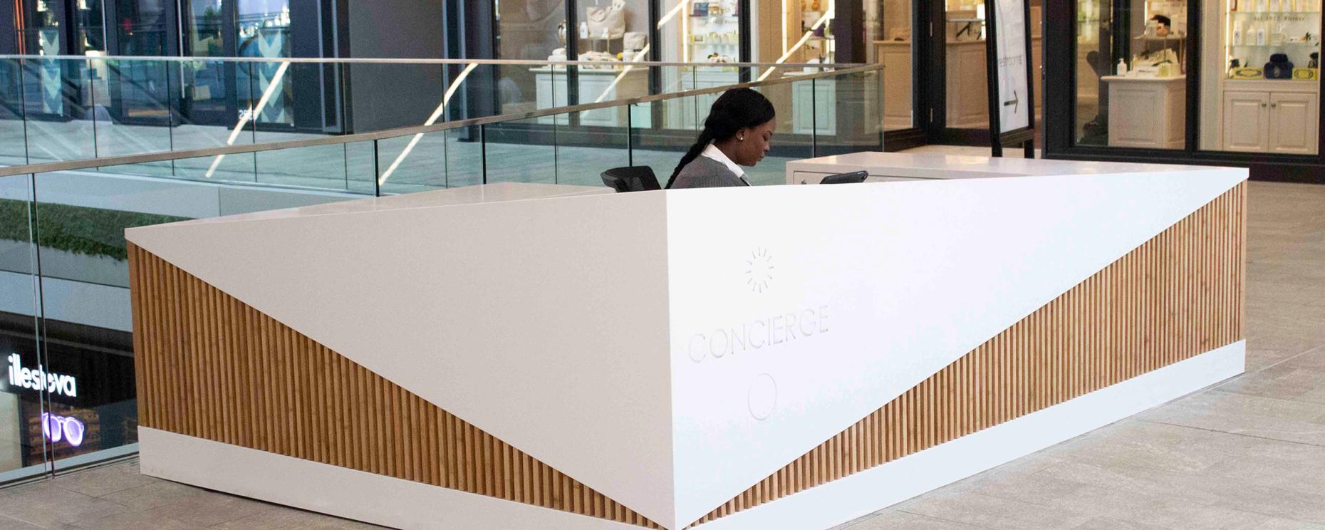 Brickell City Centre. Custom Avonite Super White and Bamboo Concierge Desk